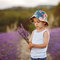 Stock Image : Adorable cute boy with a hat in a lavender field