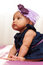 Stock Image : Adorable little african american baby girl looking - Black peopl