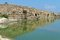 Stock Image : Ancient wall reflecting in the pond in Nahal Taninim archeological park, Israel