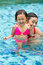 Stock Image : Asian child and mother fun in swimming pool