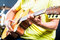 Stock Image : Asian guitarist playing music in recording studio