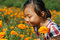 Stock Image : Asian little girl  In summer garden
