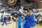 Stock Image : Auto mechanic at car suspension repair work