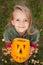 Stock Image : Autumn portrait with a Halloween pumpkin jack-o-lantern