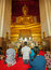 Stock Image : AYUTHAYA, THAILAND - 22 NOV 2013: Worshippers pray near the stat