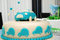 Stock Image : Baby boy blue birthday cake with car