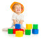 Baby boy in hard hat playing colorful building blocks