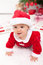 Stock Image : Baby girl in santa outfit crawling