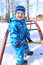 Stock Image : Baby on playground outdoors in winter