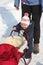 Stock Image : Baby pushing red sledge