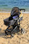 Stock Image : Baby stroller parked on the beach