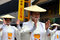 Elderly Japanese dancers in white traditional clothes during Aoba festival