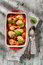 Stock Image : Baked chicken drumsticks with tomato sauce and green salad