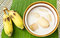 Stock Image : Banana in coconut milk and banana on banana leaves