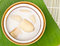 Stock Image : Banana in coconut milk on banana leaves