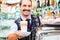 Stock Image : Barista in coffee bar offers latte macchiato in glass