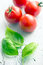 Stock Image : Basil leaves and tomatoes