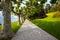 Stock Image : Beautiful european lake side garden, tree lined walkway into dis