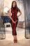 Stock Image : Beautiful girl in the latex long dress