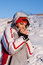 Stock Image : Beautiful girl in a ski sport suit in the snow