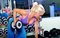 Stock Image : Beautiful muscular woman exercising in gym