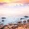 Stock Image : Beautiful sunrise over the rocky sea coast