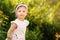 Stock Image : Beautiful Toddler a Garden Looking at Camera