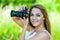 Stock Image : Beautiful woman holds camera