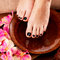 Stock Image : Beautiful women legs with black pedicure after Spa procedures
