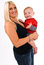 Stock Image : Beautiful young, blonde, female holding her son