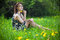 Stock Image : Beautiful young woman sitting on the grass