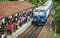 Stock Image : BENTOTA, SRI LANKA - 28 APR 2013: Train arrive to station with w