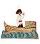 Stock Image : Black boy in costume of pirate on cardboard ship