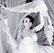 Stock Image : Black and white: bride lifted the veil