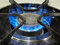 Stock Image : A blue gas top stove flame.