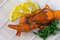 Stock Image : Boiled crayfish with a lemon and parsley