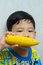 Stock Image : A boy eating boiled corn