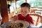 Stock Image : Boy eating noodles