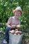 Stock Image : Boy holding bucket of potatoes