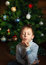 Stock Image : Boy is kissing and christmas tree