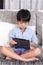 Stock Image : Boy playing digital tablet
