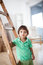 Stock Image : Boy Standing by a Ladder