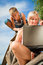 Stock Image : Boy and woman with laptop