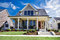 Stock Image : Brand New Custom Traditional Style Home with a Large Front Porch and Beautiful Landscaping