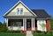 Stock Image : Brick Cape Cod Home
