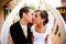 Stock Image : Bride and groom kiss