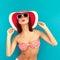 Stock Image : brunette with summer hat in rad bikini
