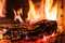 Stock Image : Burning billets in fireplace