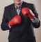 Stock Image : Businessman in boxing gloves
