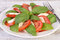 Stock Image : Caprese salad on wooden table